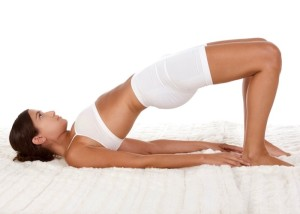 yoga pose - female in sport clothes performing exercise