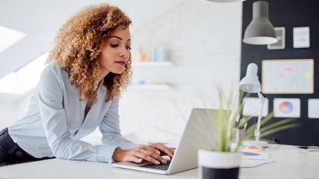 woman-curly-hair-computer